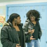 Two students walking down school hallway