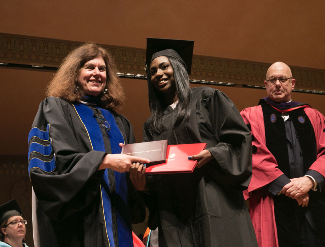 Student accepting diploma