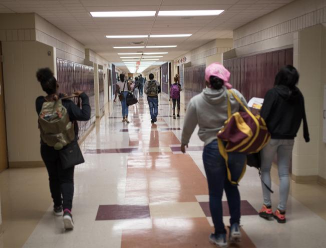 Students walking in school hallway