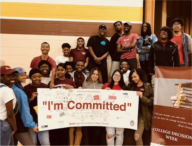 """Large group of students holding a """"I'm Committed"""" banner"""