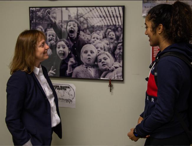 Principal and student chatting