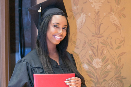 Student receiving a diploma on graduation day
