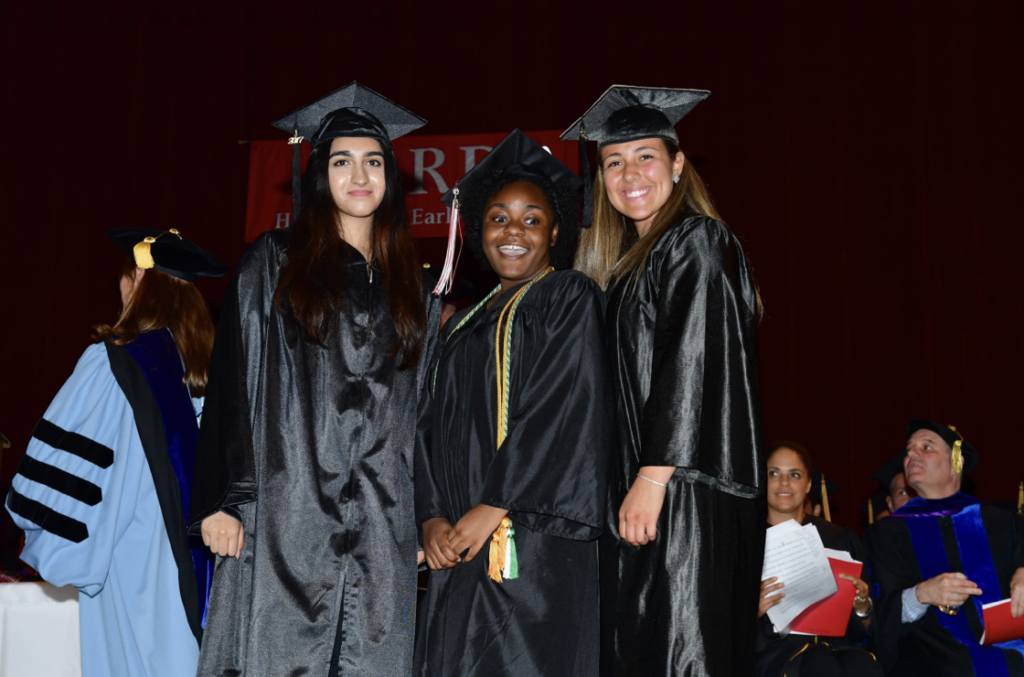 Photo of three students at graduation