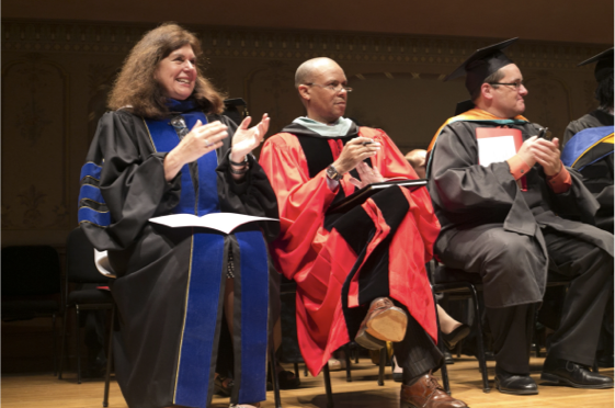 Faculty clapping at graduation